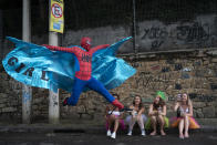 "A reveler dressed in a Spider-Man costume strikes a pose at the ""Ceu na Terra"" or Heaven on Earth street party in Rio de Janeiro, Brazil on Feb. 22, 2020, during the Carnival celebration. (AP Photo/Leo Correa)"