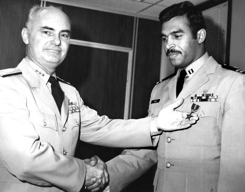 This 1970 black and white photo provided by the U.S. Coast Guard Academy in New London, Conn., shows Merle Smith, right, the first African-American graduate of the academy, receiving the Bronze Star for his service in Vietnam as a patrol boat commander from Vice Adm. Thomas Sargent in Washington.  The service academy, which is honoring Smith with a pioneer award in New London Sunday, April 1, 2012, has been facing pressure from Congress to boost enrollment of minorities, particularly African-Americans, who have accounted for roughly 5 percent of incoming cadets in recent years.  (AP Photo/U.S. Coast Guard Academy)