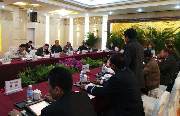Minister of the President's Office Aung Min (3rd L back, writing) holds talks with representatives of the KIA in Ruili