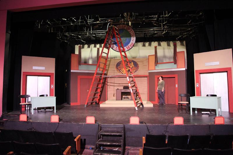 """This Thursday, Aug. 16, 2012, photo shows stagehands working on the set of """"How to Succeed in Business Without Really Trying"""" before a performance at the summer camp Stagedoor Manor in Loch Sheldrake, N.Y. The camp, open to kids from 10 to 18, was started in 1976 and each year attracts campers from across the country as well as 19 nations including Thailand, Lebanon, Russia and Saudi Arabia.(AP Photo/Mark Kennedy)"""