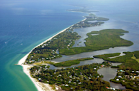 """<p>Where: Florida</p><p>Sanibel epitomizes Old Florida. You won't find a single traffic light on the island and its dark sky ordinances—meant to safeguard the turtles that nest here from May 1 through October 31—means that there are minimal streetlights. With its unique east to west orientation (most barrier islands are situated in a north/south pattern), the island is able to maintain beautiful sandy beaches that are prime spots for shelling. In fact, you can scoop up 250 different types of seashells on Sanibel's shores. J.N. """"Ding"""" Darling National Wildlife Refuge is the place to go to spy roseate spoonbills, snowy egrets, cormorants, and other birds as well as alligators, bobcats, river otters, and manatees. Vacations here are all about swimming, walking, biking, kayaking, fishing, and boating.</p><p>Insider Tip: Beachfront cottages, vintage motels, and inns are mainstays here. The Island Inn is the oldest such establishment on Sanibel, dating back to 1895.</p><p><i>(Photo: <a href=""""http://www.sanibelphoto.com/"""" rel=""""nofollow noopener"""" target=""""_blank"""" data-ylk=""""slk:David Meardon Photography"""" class=""""link rapid-noclick-resp"""">David Meardon Photography</a>)</i></p>"""