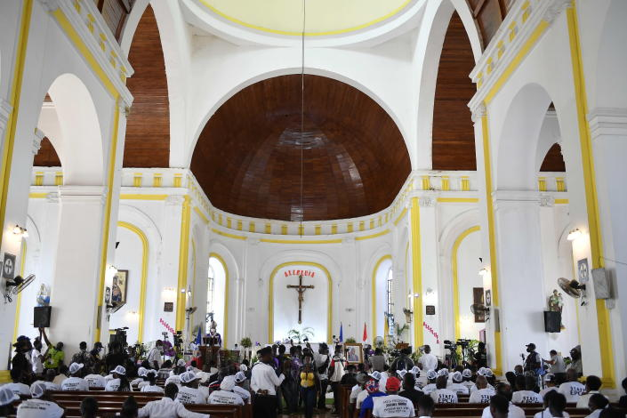 People attend a memorial service for assassinated President Jovenel Moïse in the Cathedral of Cap-Haitien, Haiti, Thursday, July 22, 2021. Moïse was killed in his home on July 7. (AP Photo/Matias Delacroix)