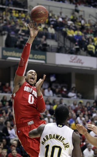 \Ohio State forward Jared Sullinger (0) goes up for a shot in the first half of an NCAA college basketball game against Michigan in the semifinals of the Big Ten Conference tournament in Indianapolis, Saturday, March 10, 2012. At right is Michigan guard Tim Hardaway Jr. (10). (AP Photo/Michael Conroy)