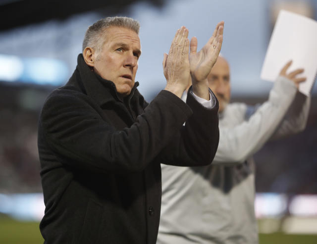 FILE - In this March 24, 2018, file photo, Sporting Kansas City's Peter Vermes acknowledges fans as he takes the pitch to lead his team against the Colorado Rapids in an MLS soccer match in Commerce City, Colo. Sporting Kansas City manager and technical director Peter Vermes has signed a contract extension that could keep him with the Major League Soccer club through the 2023 season. Sporting KC announced the deal in a statement Monday, May 7, 2018. (AP Photo/David Zalubowski, File)