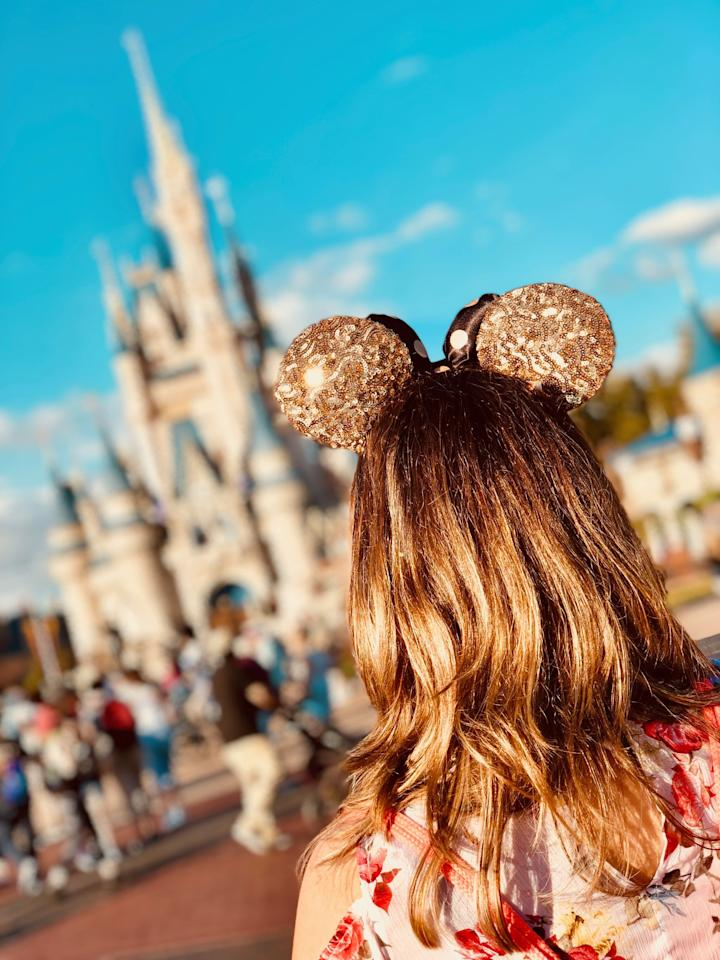 """<p>""""Growing up in Florida, I went to Disney at least once a year as a kid, yet I don't remember a single family vacation there. Why? Because I was a child, and I didn't appreciate anything. As an adult, I love going to Disney World because all of the magic and whimsy actually lifts me out of the everyday cynicism I gravitate toward all too often. I'm not a big roller coaster fan, so 'grown up' amusement parks don't do it for me. I want to remember that all of my dreams can come true, magic exists, and I will find my happily every after one day. I don't know who needs reminding of that more than the young adults of today."""" - Chari Perez, social media and partnerships coordinator</p>"""