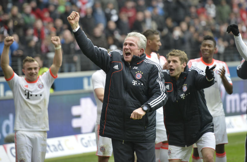 Bayern head coach Jupp Heynckes celebrates after the German first division Bundesliga soccer match between Eintracht Frankfurt and Bayern Munich in Frankfurt, Germany, Saturday, April 6, 2013. Bayern Munich wrapped up the German title in record time by winning 1-0 at Eintracht Frankfurt on Saturday with six rounds left in the season, an unprecedented feat in 50 years of the Bundesliga.(AP Photo/Martin Meissner)