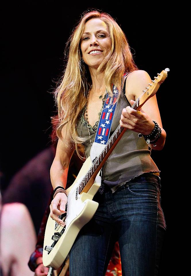 """While Sheryl Crow is so famous now that she's ventured into other projects -- most recently a cookbook, <i>If It Makes You Healthy</i> -- she's first and foremost a musician known for bluesy, guitar-heavy tunes like """"All I Wanna Do."""" Skip Bolen/Alabama Relief/<a href=""""http://www.gettyimages.com/"""" target=""""new"""">GettyImages.com</a> - June 14, 2011"""