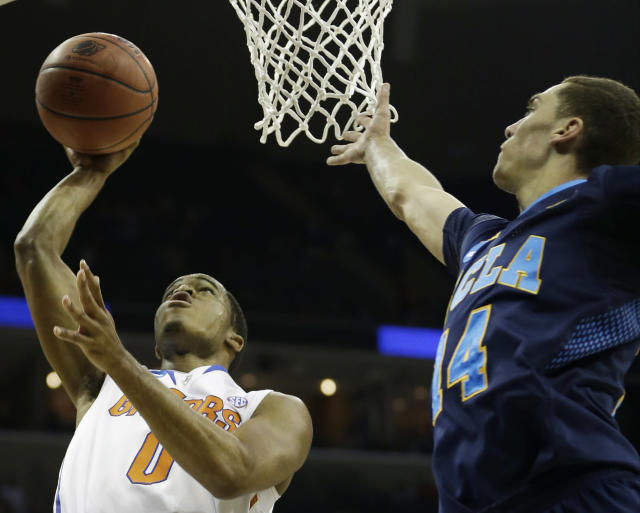 Florida Kasey Hill shoots as UCLA guard Zach LaVine (14) looks on during the first half in a regional semifinal game at the NCAA college basketball tournament, Thursday, March 27, 2014, in Memphis, Tenn. (AP Photo/Mark Humphrey)