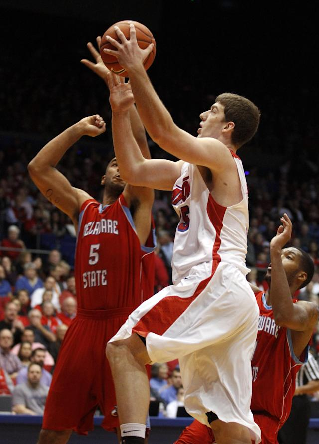 Dayton's Matt Kavanaugh (35) drives for a basket against Delaware State's Tyshawn Bell(5) in the first half of an NCAA college basketball game on Wednesday, Dec. 4, 2013, in Dayton, Ohio. (AP Photo/Skip Peterson)