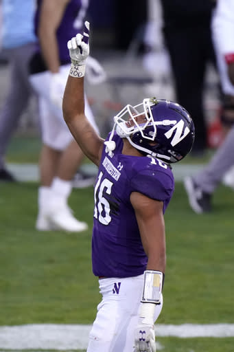 Northwestern defensive back Brandon Joseph celebrates after intercepting a pass during the first half of an NCAA college football game against Wisconsin in Evanston, Ill., Saturday, Nov. 21, 2020. (AP Photo/Nam Y. Huh)