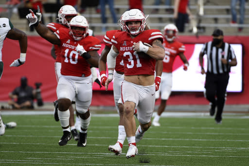Houston defensive lineman Derek Parish (31) runs back a fumble for a touchdown during the second half of an NCAA college football game against South Florida, Saturday, Nov. 14, 2020, in Houston. (AP Photo/Eric Christian Smith)