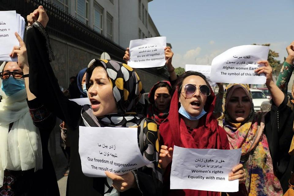 Women gather to demand their rights under the Taliban rule during a protest in Kabul, Afghanistan. (AP)