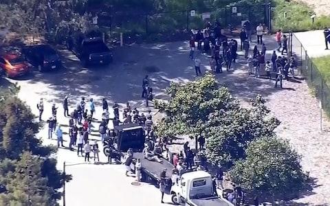 Local television images show employees being evacuated from the California Youtube campus - Credit: Universal News