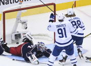 Toronto Maple Leafs right wing William Nylander (88) scores past Columbus Blue Jackets goaltender Joonas Korpisalo (70) as Leafs center John Tavares (91) watches during the second period of an NHL hockey playoff game Thursday, Aug. 6, 2020, in Toronto. (Nathan Denette/The Canadian Press via AP)
