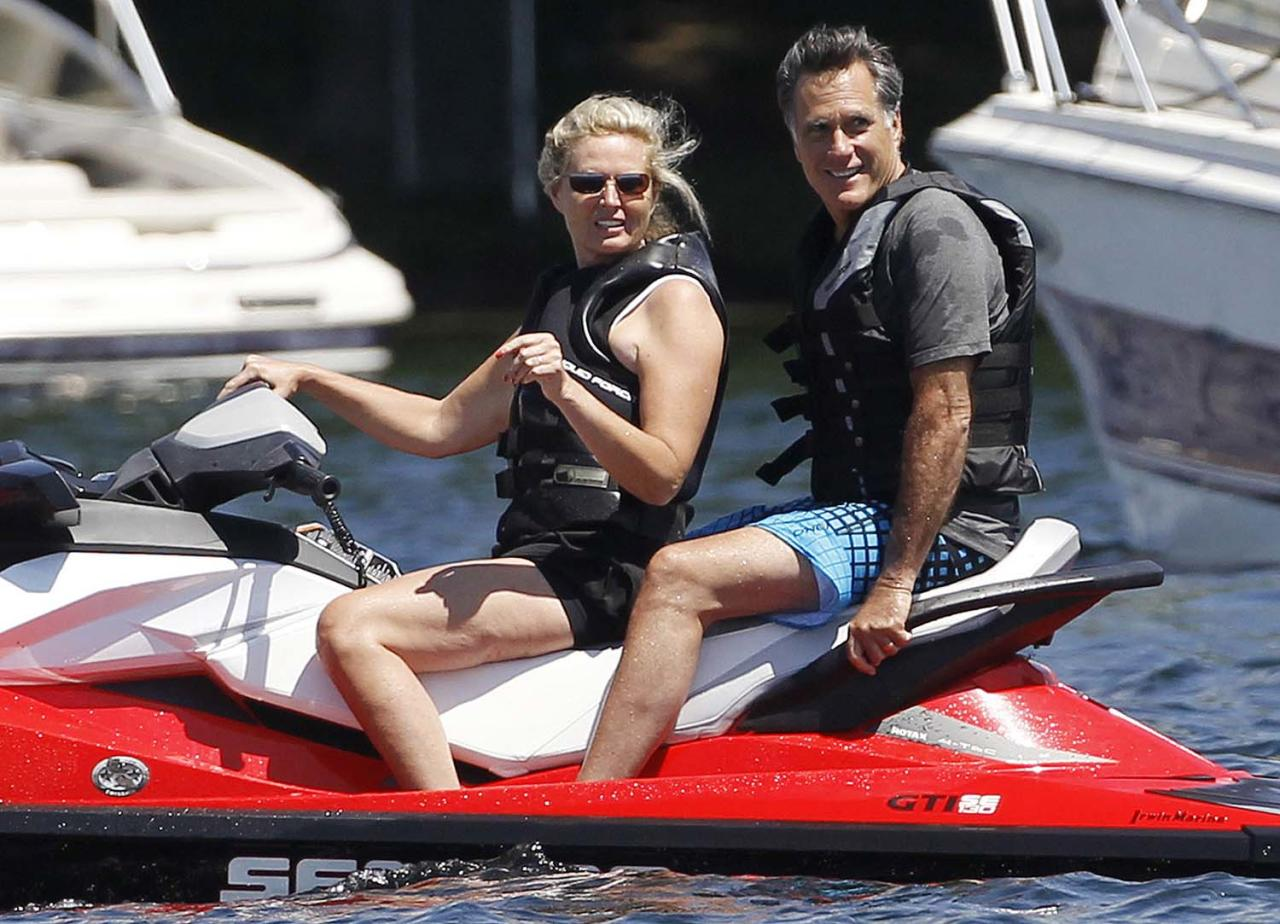 Republican presidential candidate, former Massachusetts Gov. Mitt Romney and wife Ann Romney jet ski on Lake Winnipesaukee in Wolfeboro, N.H., Monday, July 2, 2012, where Romney has a vacation home. (AP Photo/Charles Dharapak)