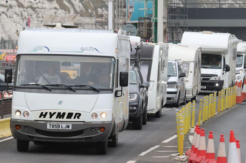 A line of mobile homes and caravans leaving the Port of Dover, Kent, as travellers try to get back from France to avoid quarantine restrictions. (Photo: Gareth Fuller - PA Images via Getty Images)