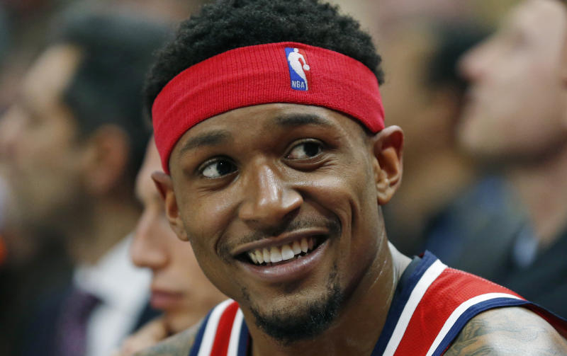 Washington Wizards guard Bradley Beal (3) smiles as he sits on the bench during the second half of an NBA basketball game against the Utah Jazz Friday, March 29, 2019, in Salt Lake City. (AP Photo/Rick Bowmer)