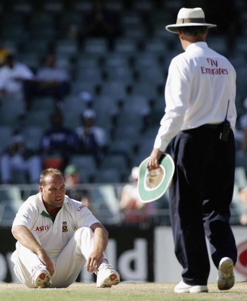 JOHANNESBURG, SOUTH AFRICA - APRIL 03:  Jacques Kallis of South Africa ends up on the ground in his follow through as umpire Tony Hill looks on during day four of the Third Test between South Africa and Australia played at Wanderers Stadium on April 3, 2006 in Johannesburg, South Africa.  (Photo by Hamish Blair/Getty Images)