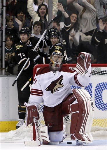 Dallas Stars' Alex Goligoski, right rear, congratulates Michael Ryder (73) on his goal against Phoenix Coyotes goalie Mike Smith in the second period of an NHL hockey game Tuesday, March 20, 2012, in Dallas. The score was one of two for Ryder in the period. (AP Photo/Tony Gutierrez)