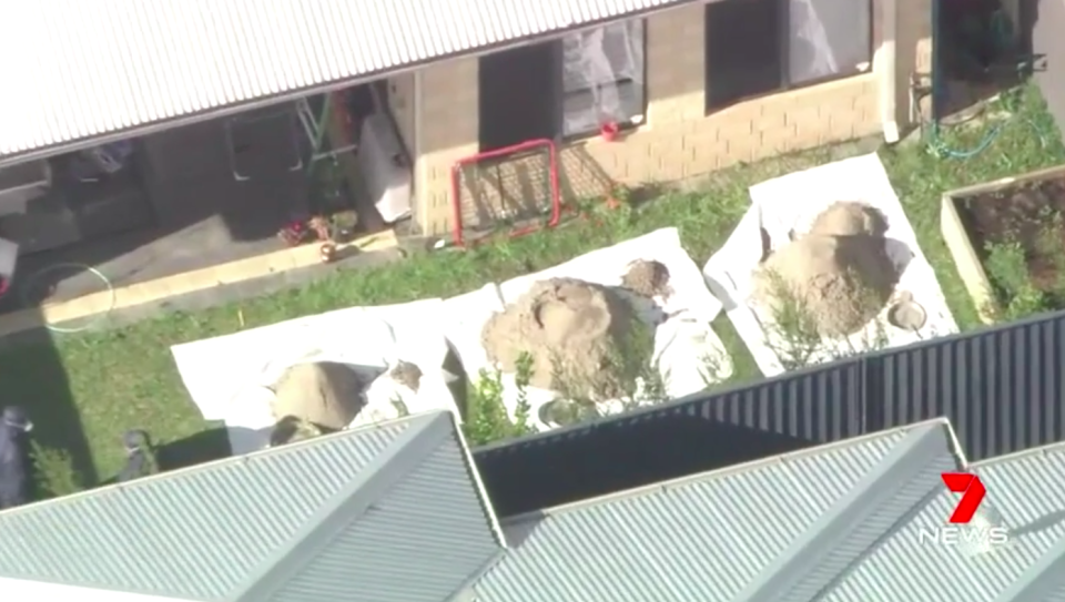 On Wednesday afternoon forensic officers began digging up the backyard of the Carlisle home. Source: 7 News