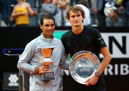Tennis - ATP World Tour Masters 1000 - Italian Open - Foro Italico, Rome, Italy - May 20, 2018 Spain's Rafael Nadal poses with the winners trophy and Germany's Alexander Zverev poses with the runner up trophy after Nadal won the final REUTERS/Tony Gentile