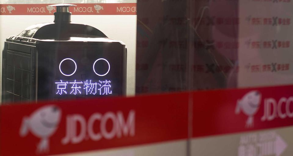 CHANGSHA, CHINA - NOVEMBER 22: A driverless delivery vehicle of Chinese e-commerce company JD.com works at JD's unmanned intelligent distribution station on November 22, 2018 in Changsha, Hunan Province of China. JD's unmanned intelligent distribution station in Changsha covers an area of 600 square metres, which can store 20 driverless delivery vehicles. These driverless delivery vehicles will take delivery packages to their designated places. (Photo by VCG/VCG via Getty Images)