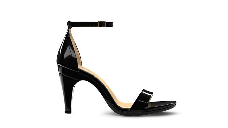 """Pashion Footwear's """"Pashionista"""" style features a classic silhouette updated for the modern woman. Soft patent leather complements a simple and chic design with an adjustable ankle strap and gold buckle."""