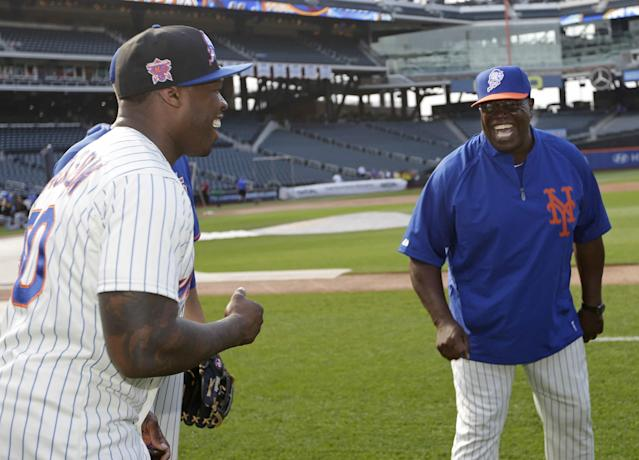 New York Mets batting coach Lamar Johnson, right, talks with rapper 50 Cent before the Mets' baseball game against the Pittsburgh Pirates on Tuesday, May 27, 2014, in New York. (AP Photo/)