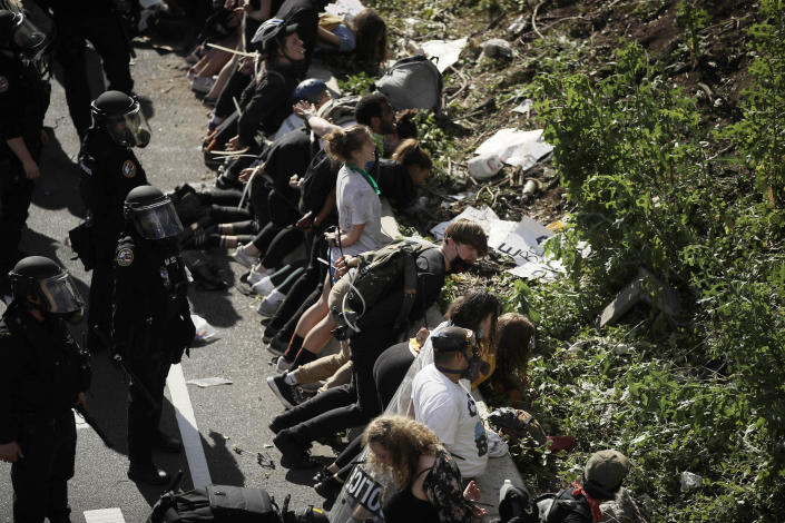 FILE—In this file photo from June 1, 2020, police detain protesters along Interstate 676 in Philadelphia in the aftermath of a march calling for justice over the death of George Floyd. Floyd died after being restrained by Minneapolis police officers on May 25. Philadelphia's mayor and police chief are scheduled to give an update Thursday, June 25, 2020, on the investigation into the police use of tear gas and rubber bullets on demonstrators who had made it onto Interstate 676 in the early June protest. (AP Photo/Matt Rourke, File)