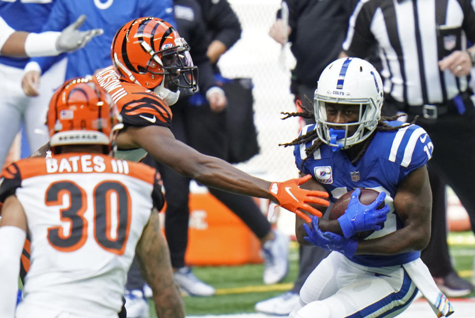 Indianapolis Colts' T.Y. Hilton (13) is tackled by Cincinnati Bengals' William Jackson (22) and Jessie Bates (30) during the first half of an NFL football game, Sunday, Oct. 18, 2020, in Indianapolis. (AP Photo/AJ Mast)