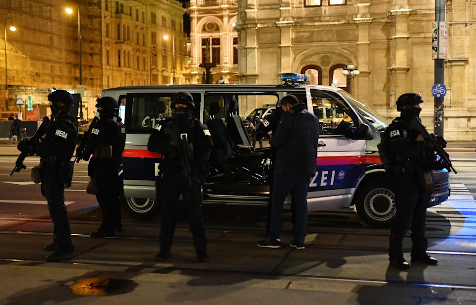 """Armed policemen stand out of their car near the State Opera in the center of Vienna on November 2, 2020, following a shooting. - Two people, including one attacker, have been killed in a shooting in central Vienna, police said late November 2, 2020. Vienna police said in a Twitter post there had been """"six different shooting locations"""" with """"one deceased person"""" and """"several injured"""", as well as """"one suspect shot and killed by police officers"""". (Photo by JOE KLAMAR / AFP) (Photo by JOE KLAMAR/AFP via Getty Images)"""