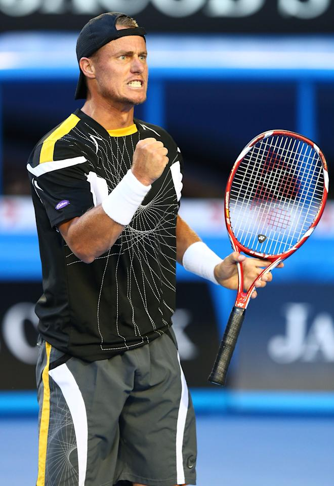 MELBOURNE, AUSTRALIA - JANUARY 14:  Lleyton Hewitt of Australia celebrates winning the first game in his first round match against Janko Tipsarevic of Serbia during day one of the 2013 Australian Open at Melbourne Park on January 14, 2013 in Melbourne, Australia.  (Photo by Ryan Pierse/Getty Images)