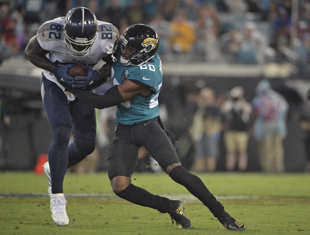 Jacksonville Jaguars cornerback Jalen Ramsey (20) stops Tennessee Titans tight end Delanie Walker (82) after a catch during the first half of an NFL football game Thursday, Sept. 19, 2019, in Jacksonville, Fla. (AP Photo/Phelan Ebenhack)