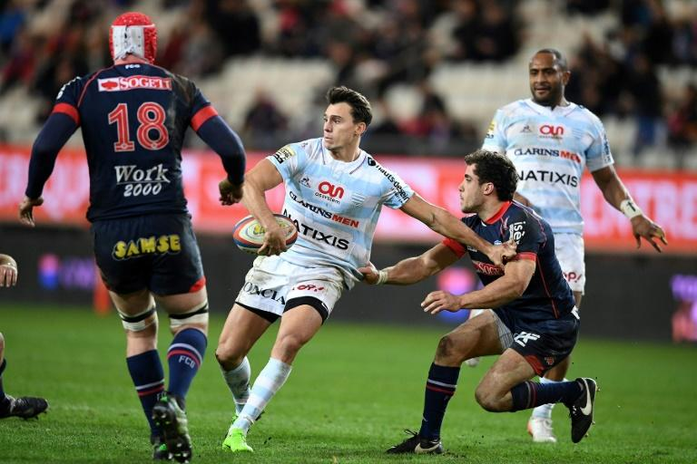 Racing's winger Juan Imhoff (C) runs with the ball during the French Top 14 rugby union match against Grenoble March 4, 2017