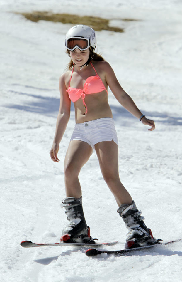 Allie Ward, 15, from Prince Edward Island, Canada, enjoys the warm sun while skiing in unusual weather for this time of year at Sunday River in Newry, Maine, on Wednesday, March 21, 2012. (AP Photo/Pat Wellenbach)