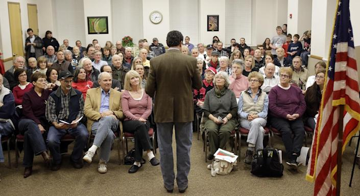 In this Feb. 7, 2013 photo, Rep. Jason Chaffetz, R-Utah, makes remarks during a town hall meeting in Heber City, Utah. Chaffetz flew home from Washington last week to attend the town hall meeting. Many voters here and in similar communities elsewhere still want to do whatever it takes to stop President Obama, and the politicians they elect are listening. (AP Photo/Rick Bowmer)