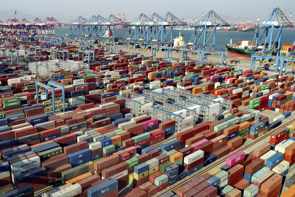 In this aerial photo, shipping containers are seen at a container port in Qingdao in eastern China's Shandong Province, Friday, Feb. 19, 2021. Chinese leaders are shifting focus from the coronavirus back to long-term goals of making China a technology leader at this year's highest-profile political event, the meeting of its ceremonial legislature, amid tension with Washington and Europe over trade, Hong Kong and human rights. (Chinatopix via AP)