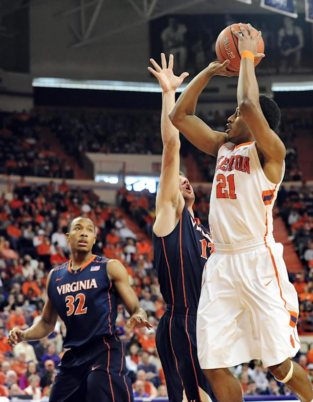 Clemson's Damarcus Harrison, right, shoots a jumper while being pressured by Virginia's Joe Harris during the first half of an NCAA college basketball game Saturday, Feb. 15, 2014, at Littlejohn Coliseum in Clemson, S.C.(AP Photo/ Richard Shiro)