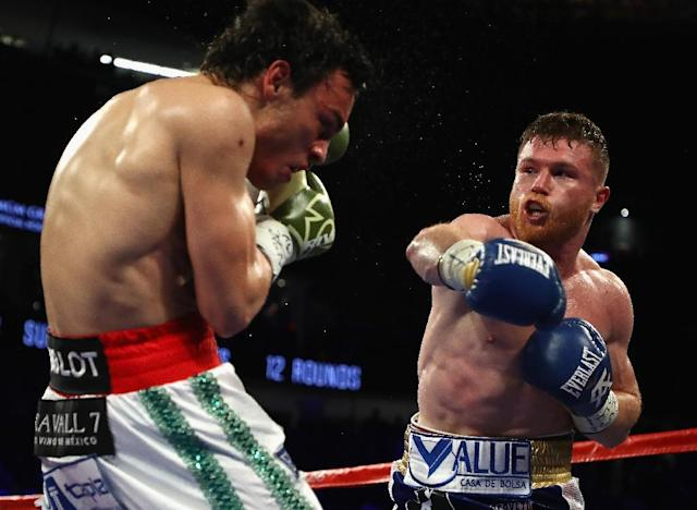 Saul 'Canelo' Alvarez (R) punches Julio Chavez Jr. during their catchweight bout at T-Mobile Arena in Las Vegas, Nevada, on May 6, 2017 (AFP Photo/Al Bello)