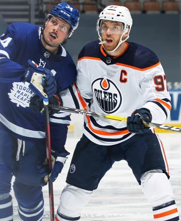Auston Matthews, left, and Connor McDavid, right, are two of the biggest offensive threats in the NHL. Their respective teams begin a three-game series in Edmonton on Saturday, but Matthews will miss at least the first game due to an injury. (File/Getty Images - image credit)