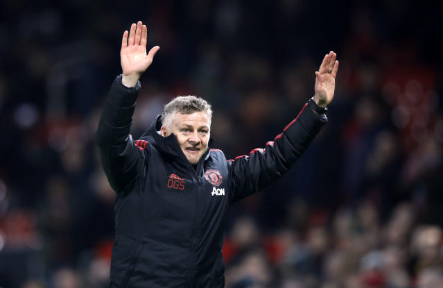 Manchester United interim manager Ole Gunnar Solskjaer celebrates defeating Huddersfield after the English Premier League soccer match at Old Trafford, Manchester, England, Wednesday Dec. 26, 2018. (Martin Rickett/PA via AP)