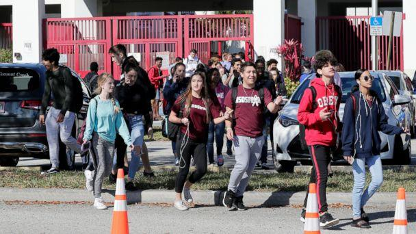 PHOTO: Students walk out of Marjory Stoneman Douglas High School, as part of a nationwide protest against gun violence, March 14, 2018, in Parkland, Fla. (Lynne Sladky/AP)