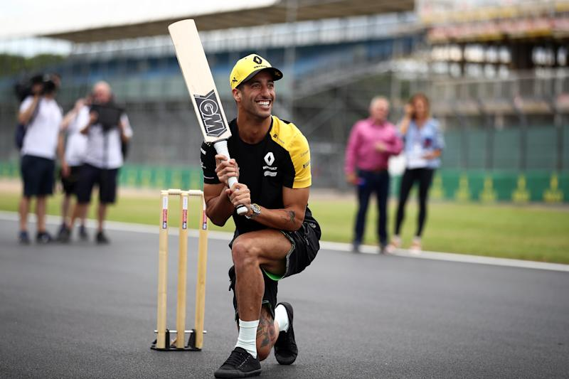 NORTHAMPTON, ENGLAND - JULY 11: Daniel Ricciardo of Australia and Renault Sport F1 plays cricket on track during previews ahead of the F1 Grand Prix of Great Britain at Silverstone on July 11, 2019 in Northampton, England. (Photo by Bryn Lennon/Getty Images)