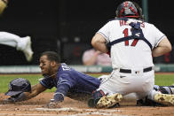 Tampa Bay Rays' Wander Franco scores as Cleveland Indians catcher Austin Hedges gathers in the throw during the second inning of a baseball game Friday, July 23, 2021, in Cleveland. (AP Photo/Tony Dejak)