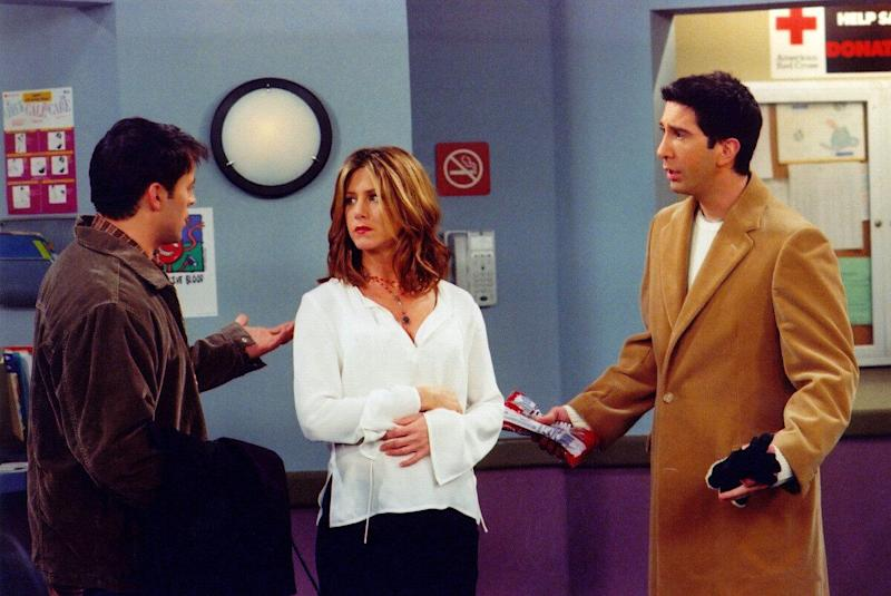 Actors Matt Le Blanc (L), Jennifer Aniston (C) and David Schwimmer are shown in a scene from the NBC series 'Friends'. The series received 11 Emmy nominations, including outstanding comedy series, by the Academy of Television Arts and Sciences July 18, 2002 in Los Angeles, California. (Photo by Warner Bros. Television/Getty Images)