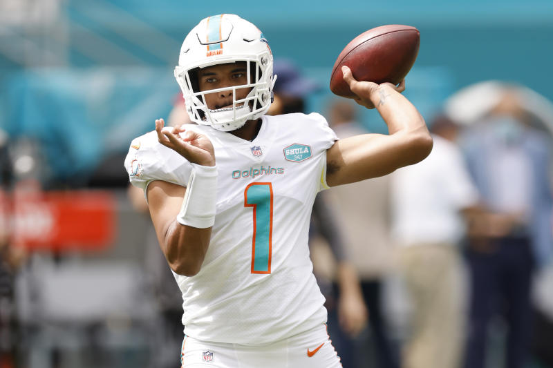 MIAMI GARDENS, FLORIDA - OCTOBER 04: Tua Tagovailoa #1 of the Miami Dolphins warms up prior to the game against the Seattle Seahawks at Hard Rock Stadium on October 04, 2020 in Miami Gardens, Florida. (Photo by Michael Reaves/Getty Images)