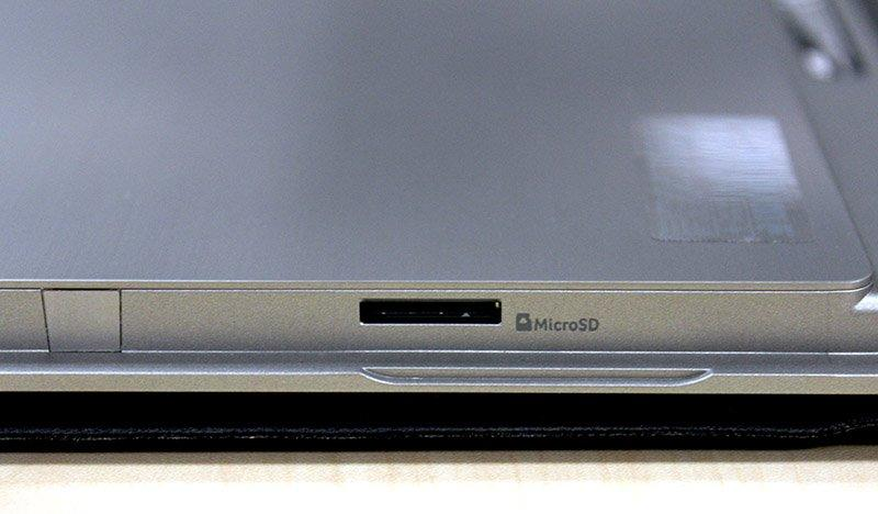The Switch Alpha 12's microSD carder reader is hidden on the side behind the integrated kickstand.