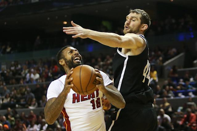 Basketball - NBA Global Games - Brooklyn Nets v Miami Heat - Arena Mexico, Mexico City, Mexico December 9, 2017. James Johnson of Miami Heat and Tyler Zeller of Brooklyn Nets in action. REUTERS/Edgard Garrido