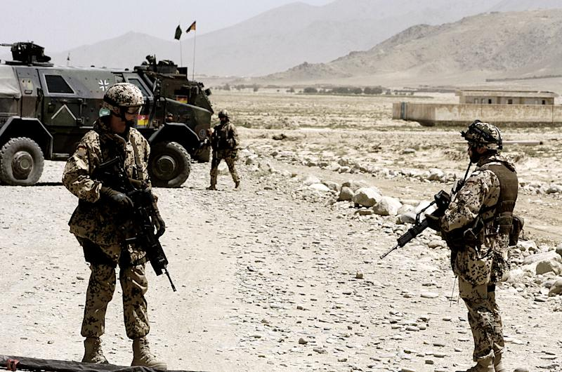 German soldiers of the International Security Assistance Force (ISAF) stand guard near the site of a bomb blast in the Afghan capital Kabul, on August 15, 2007