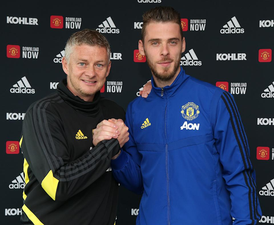 David de Gea poses with Manager Ole Gunnar Solskjaer after signing his new contract. (Photo by John Peters/Manchester United via Getty Images)